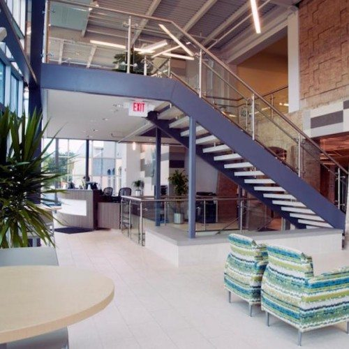 Interior View of Glass Handrail on Staircase | Town Lake YMCA | Commercial Projects | Anchor-Ventana