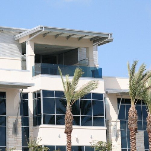 Exterior View of Entire Building with Curtain Wall Systems & Glass Railings | J&J Worldwide | Commercial Projects | Anchor-Ventana