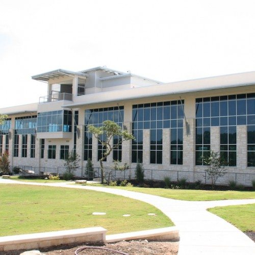 Corner Exterior View of Entire Building with Curtain Wall Systems | J&J Worldwide | Commercial Projects | Anchor-Ventana
