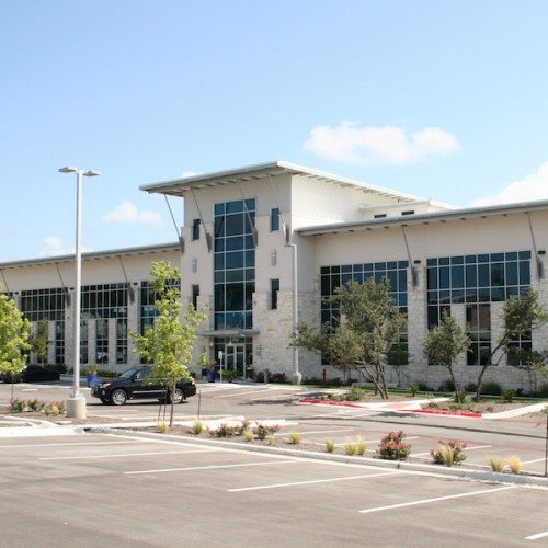 Exterior View of Entire Building with Curtain Wall Systems | J&J Worldwide | Commercial Projects | Anchor-Ventana