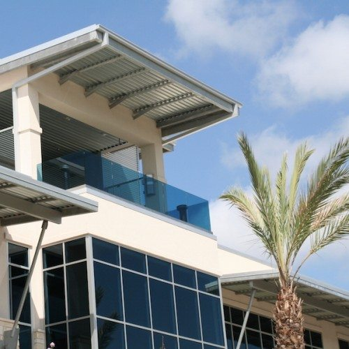 Exterior View of Glass Railing & Curtain Wall System on Building | J&J Worldwide | Commercial Projects | Anchor-Ventana