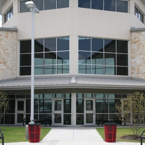 Exterior View of Glass Curtain Wall System Above Storefront Entrance Doors | Lake Travis Middle School | Commercial Projects | Anchor-Ventana