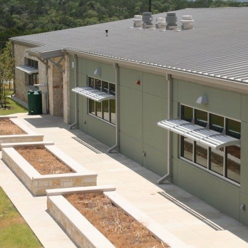 Exterior View of Glass Windows with Sunshades from Above   Lake Travis Middle School   Commercial Projects   Anchor-Ventana