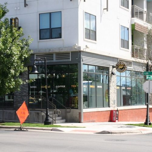 Corner View of Local Business Storefronts on Lower Level of Building Exterior | Corazon Apartments | Commercial Projects | Anchor-Ventana