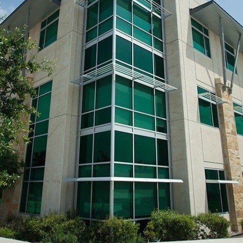 Exterior Corner View of Building with Curtain Wall Systems & Windows with Sunshades | LCRA Office Buildings | Commercial Projects | Anchor-Ventana Glass