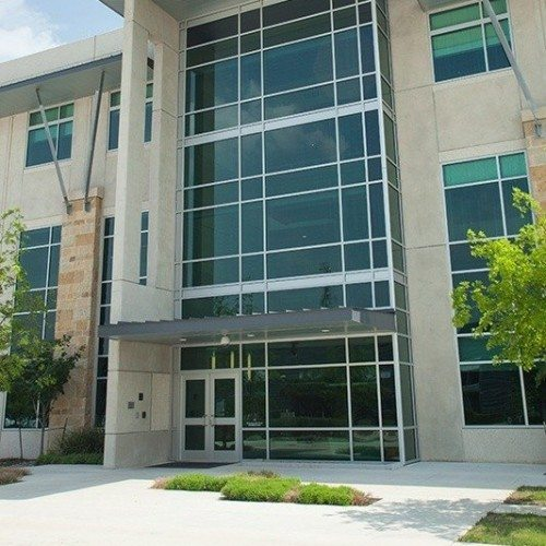 Exterior View of Curtain Wall System, Storefront Entrance Doors & Sunshades | LCRA Office Buildings | Commercial Projects | Anchor-Ventana Glass