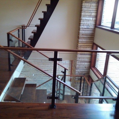 Commercial Building Interior with Glass Handrails for Staircase paired with Wood | Commercial Glass Handrails | Commercial Products | Anchor-Ventana Glass