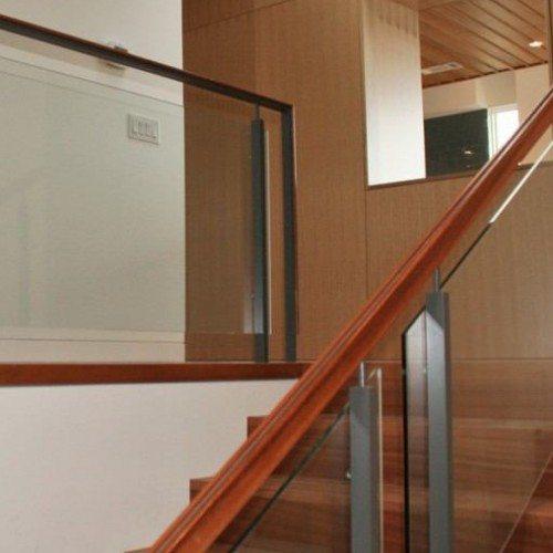 Custom Glass Handrail with Standoff Hardware in Stairway   Commercial Glass Handrails   Commercial Products   Anchor-Ventana Glass
