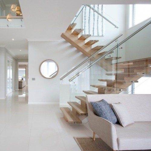 Glass Handrail System with Standoffs in Stairway | Glass Handrail Systems | Residential Gallery | Anchor-Ventana Glass