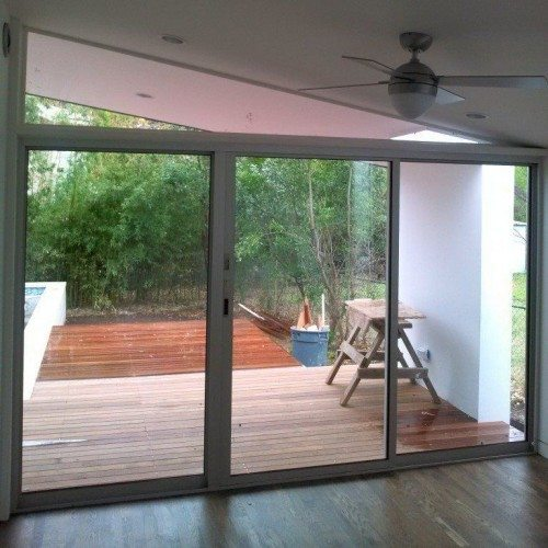 Angled Custom Window Above Doors From Patio to Living Room | Glass Wall Systems Gallery | Residential Products | Anchor-Ventana Glass
