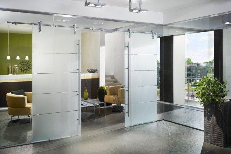 Dorma Manet Sliding Interior Door With Tint Stripes Separating Living Room Entry