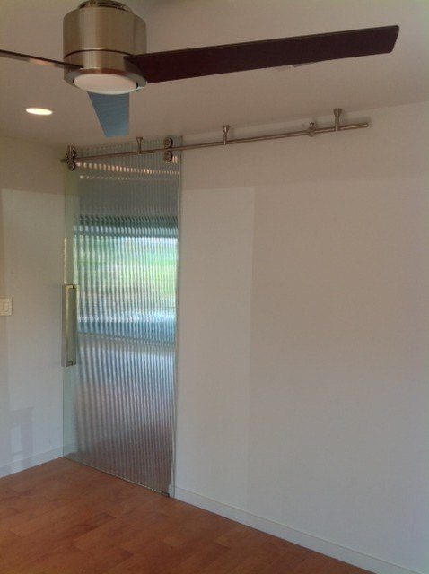 Pipeline Sliding Interior Door Featuring Reeded Glass | Glass Wall Systems  Gallery | Residential Products |
