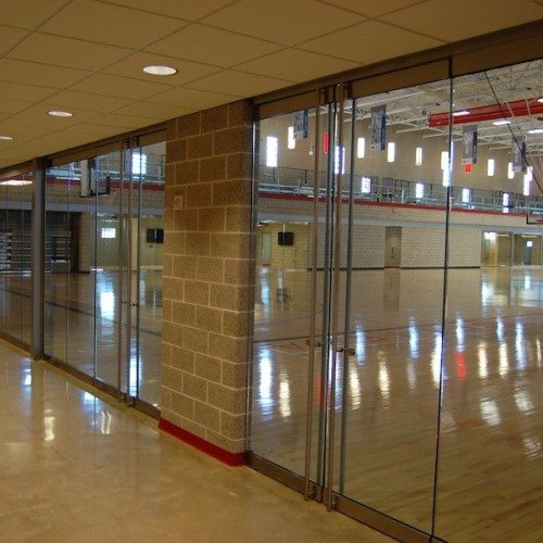 Interior View of Glass Wall System & Heavy Glass Doors | Round Rock Sports Center | Commercial Projects | Anchor-Ventana