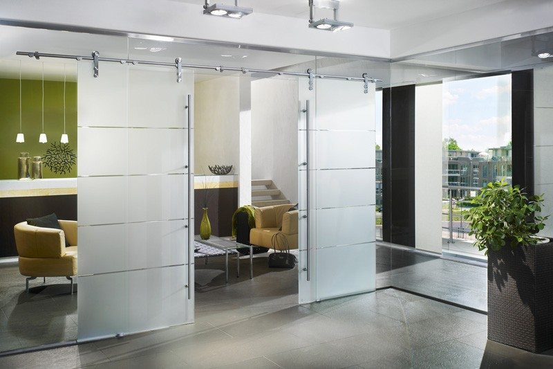 Commercial interior glass commercial gallery anchor ventana glass dorma manet sliding interior door with tint stripes separating living room and entry glass wall planetlyrics Choice Image