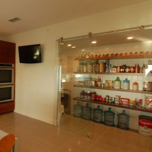 Dorma Manet Sliding Glass Door at Pantry in Break Room | Glass Wall Systems Gallery | Interior Glass Products | Anchor-Ventana Glass