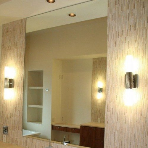 Frameless Mirror Set with J-mold at Bottom in Bathroom | Mirrors Gallery | Anchor-Ventana Glass