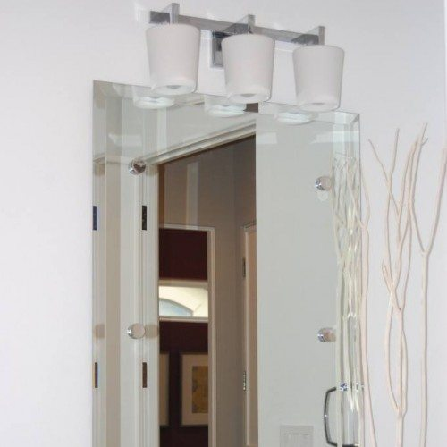 Beveled Frameless Mirror set with Standoff Caps in Powder Bath | Mirrors Gallery | Anchor-Ventana Glass