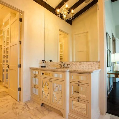 Vanity with Frameless Antique Mirrors in Cabinet Front and Mirror Above in Bathroom | Mirrors Gallery | Anchor-Ventana Glass