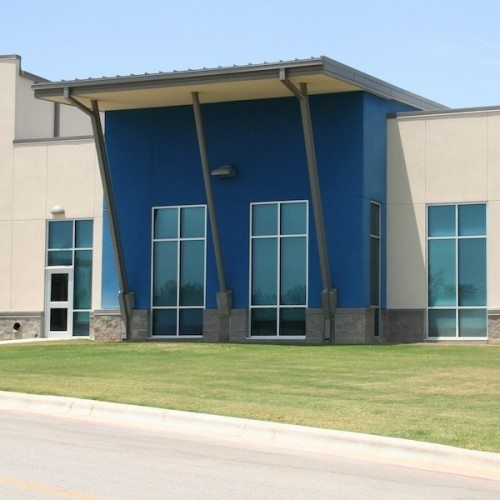 Exterior View of Glass Windows & Storefront Entrance Door on Side of the Building | Lampasas High School | Commercial Projects | Anchor-Ventana Glass