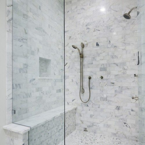 Frameless Notched Fixed Panel Set with Clamps in Bathroom | Shower Gallery | Anchor-Ventana Glass