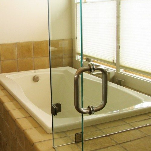Frameless Corner Shower Enclosure with Clamps at Fixed Panels in Bathroom | Shower Gallery | Anchor-Ventana Glass