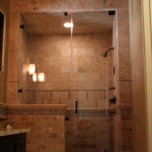Frameless Inline Steam Enclosure with Pivots on Door and Clamps on Notched Panel in Bathroom Shower | Shower Gallery | Anchor-Ventana Glass