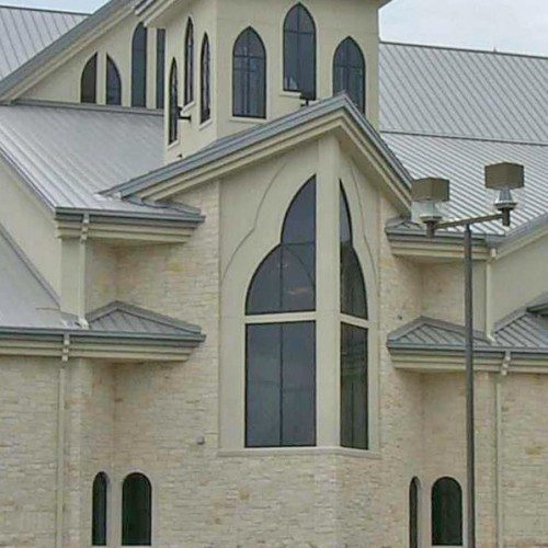 Exterior View of Custom Church Windows as Storefront | Commercial Storefronts | Commercial Products | Anchor-Ventana Glass